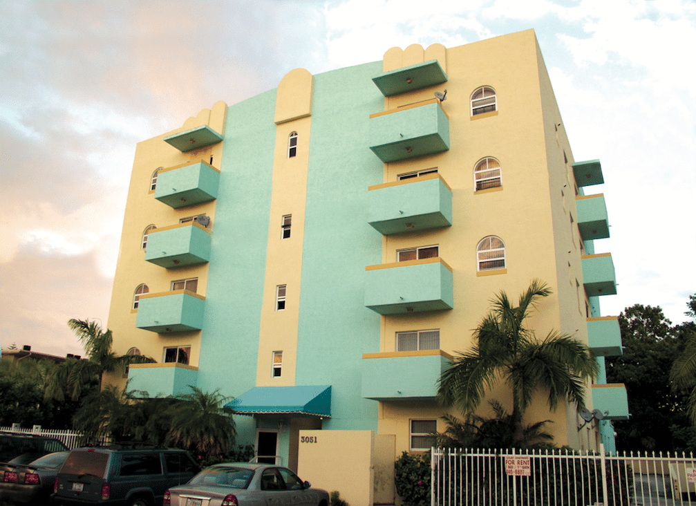Five story yellow and mint green residential condominium
