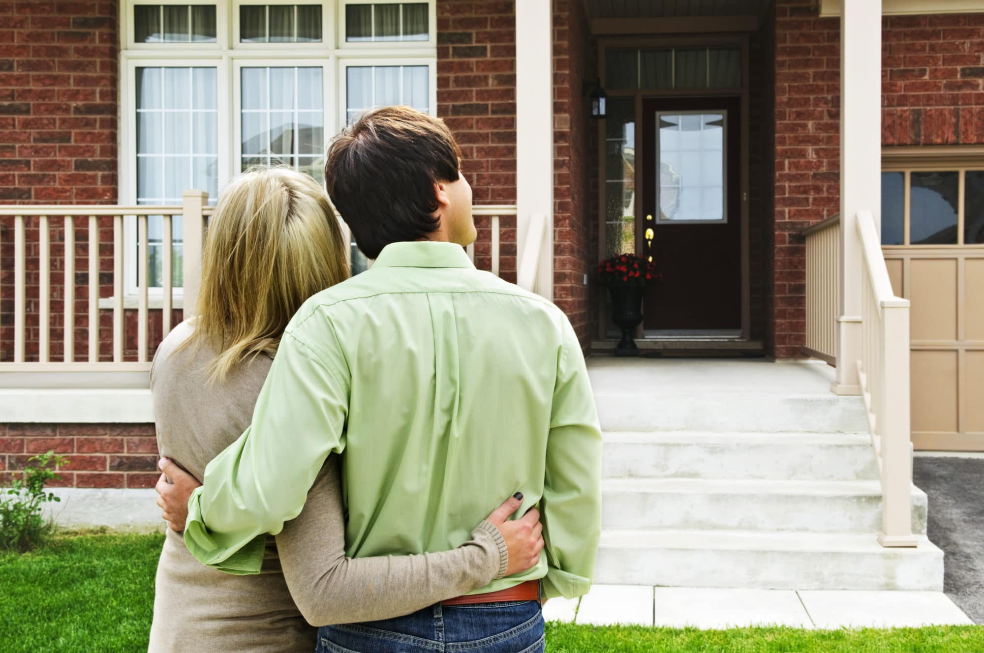 couple in front yard gazing at home
